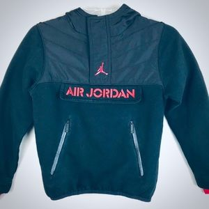 Boy's black Air Jordan half zip hoodie.